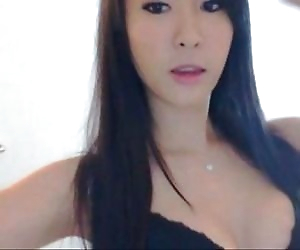 Asian Girl Strips on..